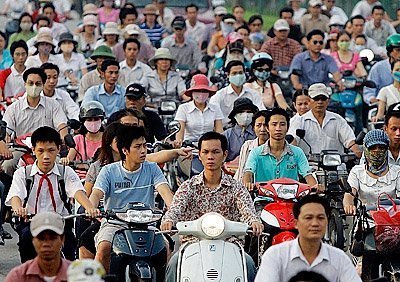 many people riding scooters in vietnam