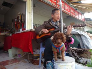 Antiques Vendor and his watch dog