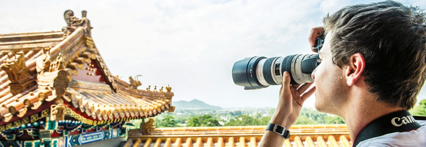 student holding camera in China summer internship skills photography