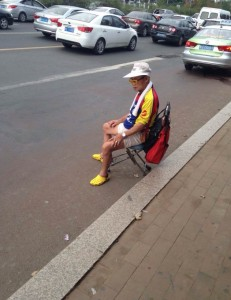 InternChina - A Chinese man waiting for the bus