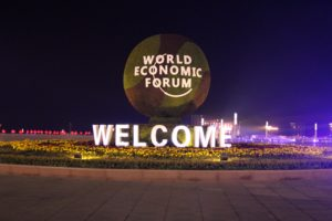 World Economic Forum Welcome sign at night at Dalian International Convention Center