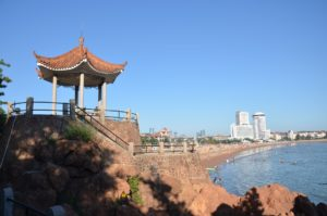 Seaside at Qingdao with a pagoda and skyscrapers in the background
