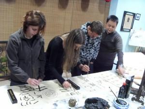 InternChina-The-Zhuhai-interns-practicing-their-new-calligraphy-skills!