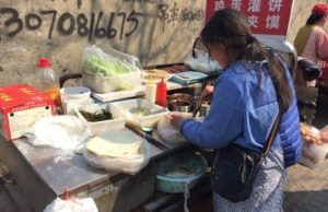 Jian Bing being prepared by a street food vendor in Qingdao