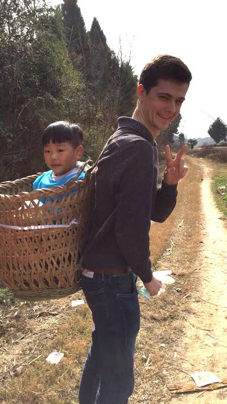 intern china homestay countryside dirt path child basket